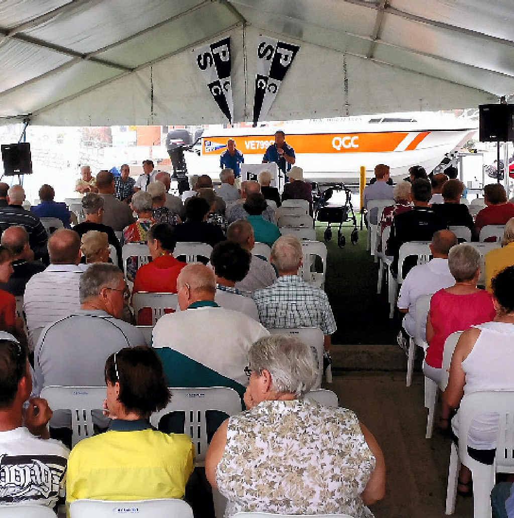 Generations of sailors hear John Ibell's address.