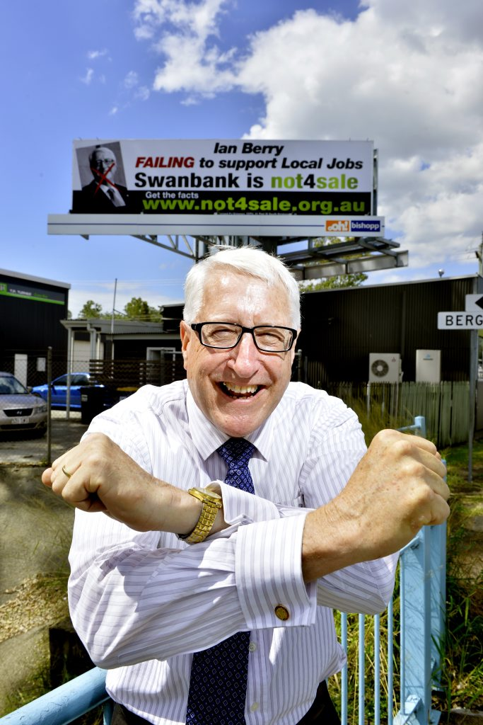Member for Ipswich Ian Berry makes light of a billboard with the 'no deal' arm gesture. The billboard was paid for the by the electrical division of the CEPU in relation to the union's perceived lack of support for local jobs from Mr Berry. Photo: Claudia Baxter / The Queensland Times