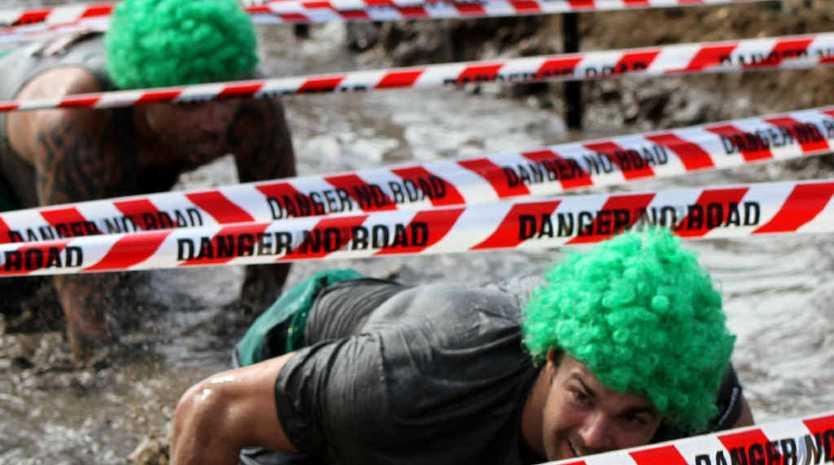 MUD MADNESS: Crossfit Vivid team members work their way through the mud sludge.