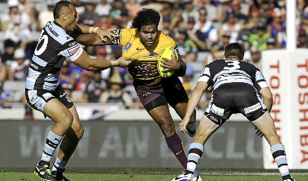 FOOTY ACTION: Sam Thaiday is tackled during the NRL Auckland Nines match.