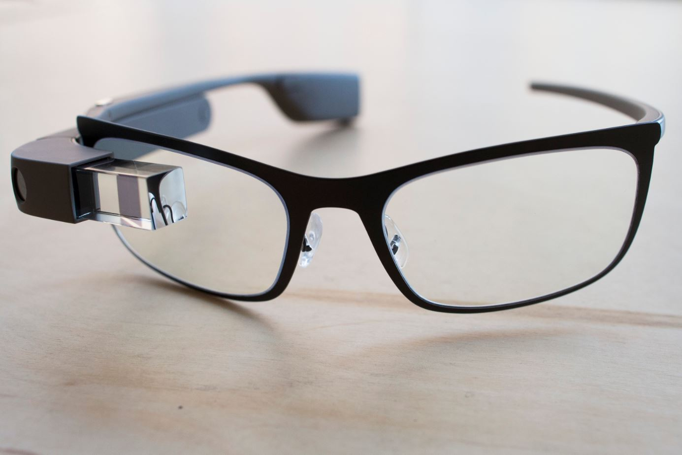 """The new Google Glass """"Bold"""" prescription frames in """"shale"""" color rests on a table at the Google Glass Basecamp space at Chelsea Market, Friday, Jan. 24, 2014, in New York. (AP Photo/John Minchillo)"""