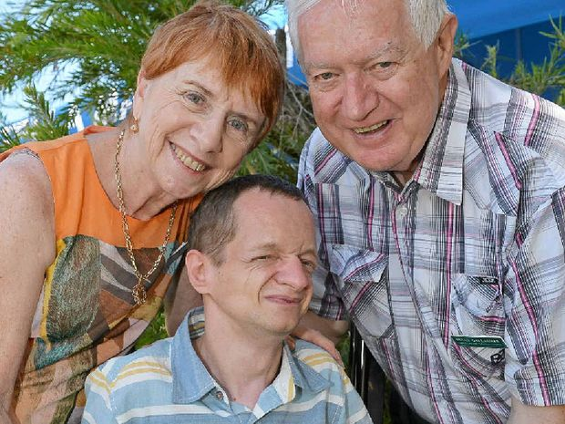 IN LIMBO: Bevan and Maureen Gallagher with their son Kieran are waiting for government assistance before Kieran can move into special accommodation.