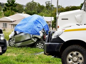 Woman killed as car is crushed between truck and tanker