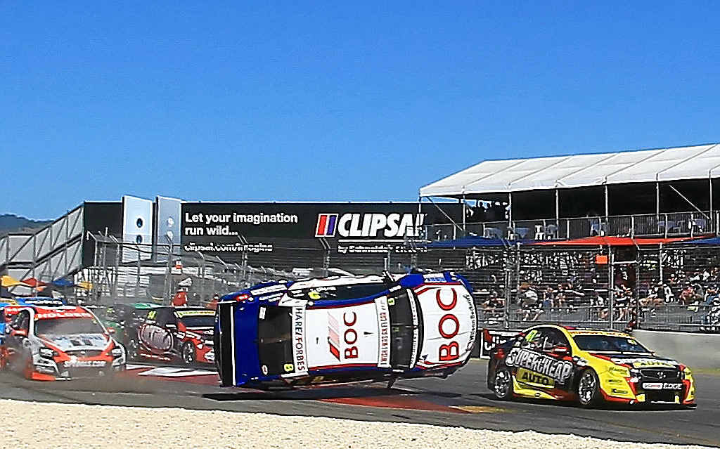 BIG MOMENT: Jason Bright's Holden flies in the air after crashing in Adelaide yesterday.