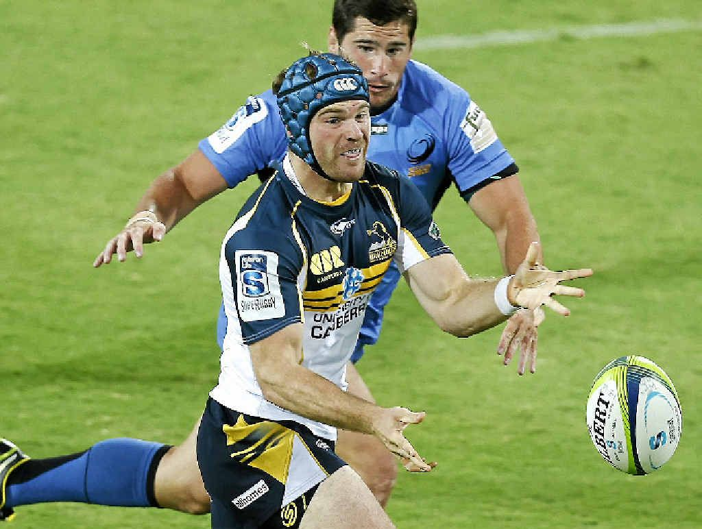 INJURY SCARE: Brumbies Pat McCabe passes the ball against the Western Force. He was later forced off with a neck injury.