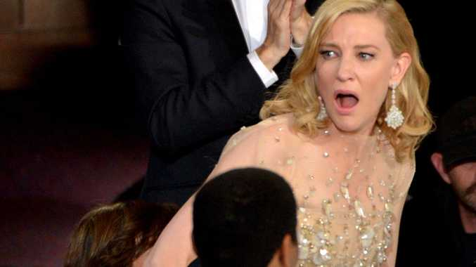 Cate Blanchett reacts after winning the award for best actress in a leading role for Blue Jasmine.