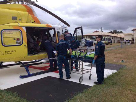 RACQ CareFlight prepare to airlift a man suffering a gunshot wound to the stomach.