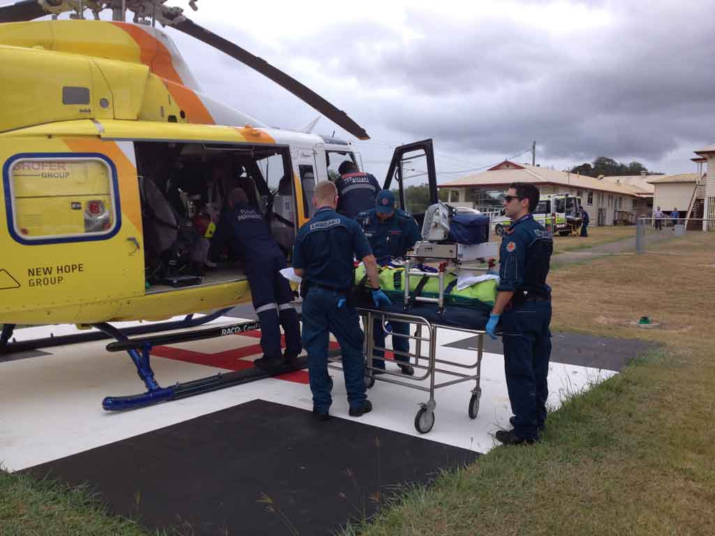 RACQ CareFlight prepare to airlift a man suffering a gunshot wound to the stomach.