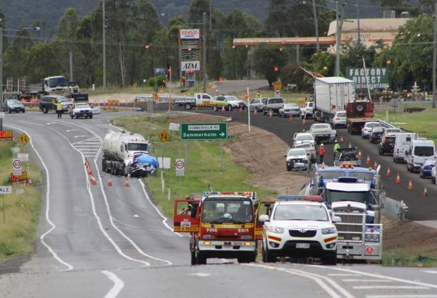 Emergency services attend a fatal car crash on the Warrego Highway at Hatton Vale.