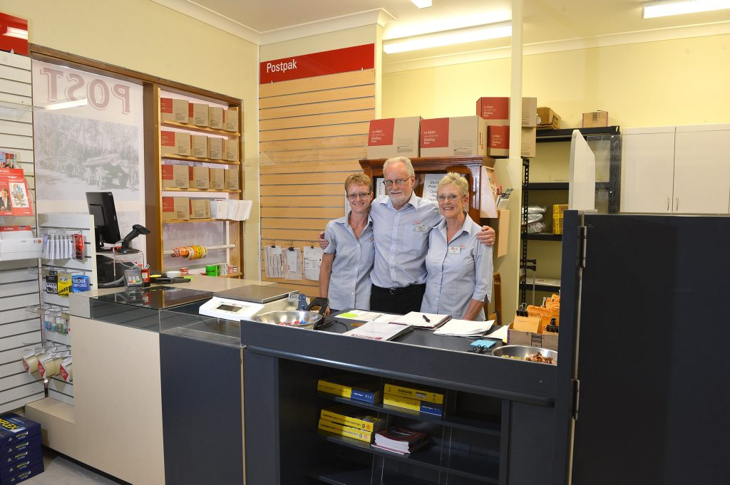 The Montville Post Office has reopened in the Montville IGA X-press Chris and Ann Wells and their daughter Sara (left) have taken on the licence. Photo: Warren Lynam / Sunshine Coast Daily