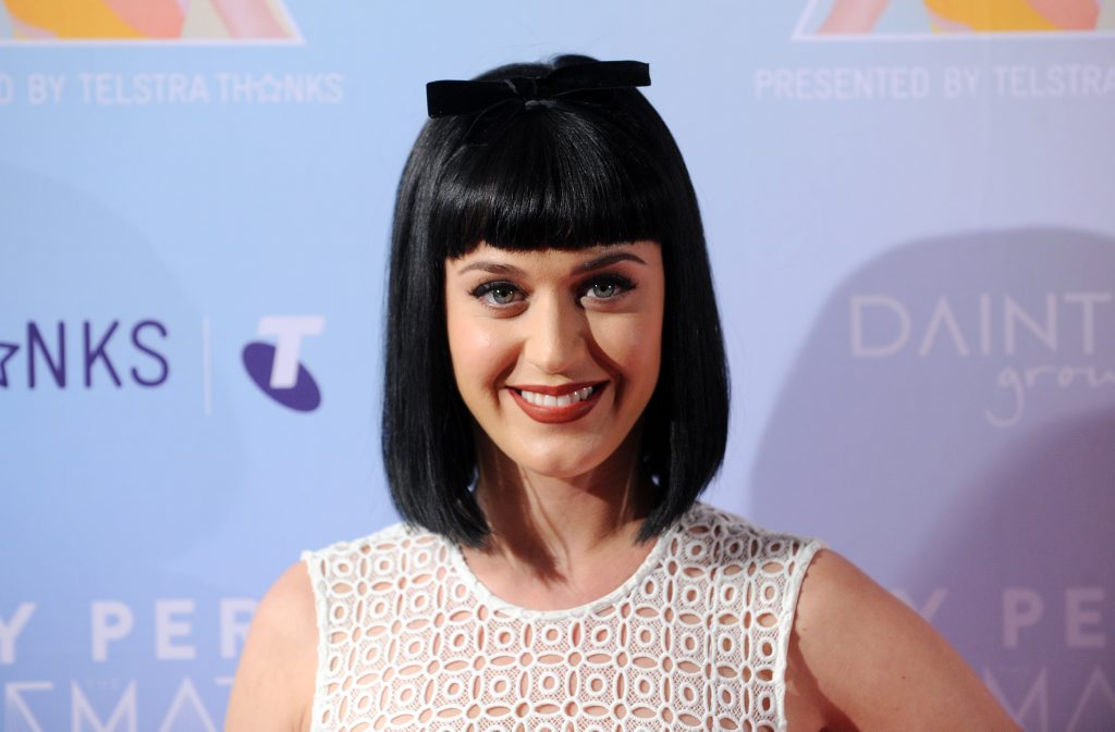 American singer Katy Perry arrives at a photo call to promote her upcoming Prismatic World Tour, in Sydney, Tuesday, March 4, 2014. The Prismatic World Tour will make its way to Australia in November.