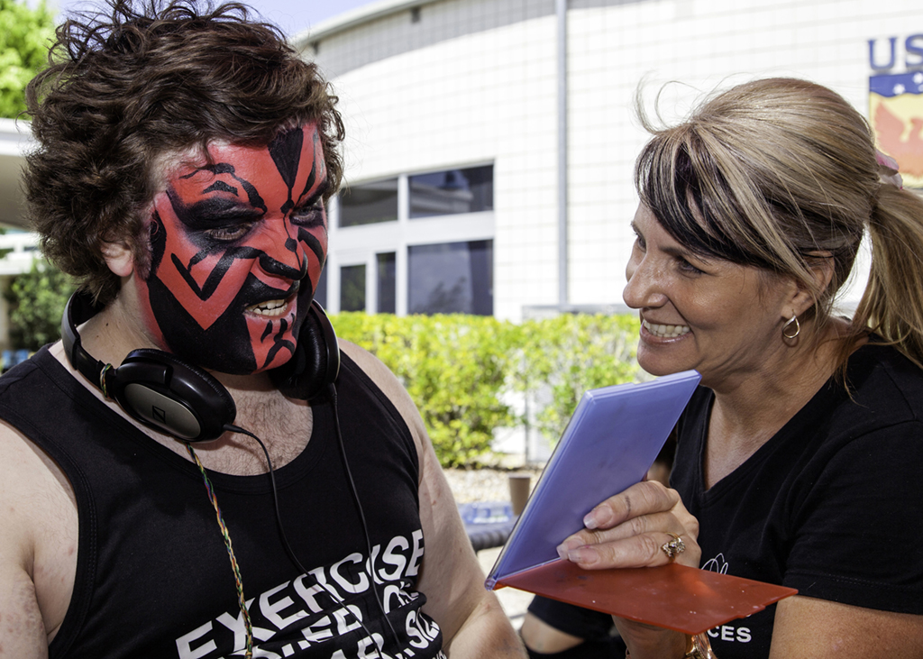 Matthew Hartvigsen takes a look in a mirror after having his face painted by Leanne Hodges from Fantasea Faces at last year's USQ Phoenix Carnival.