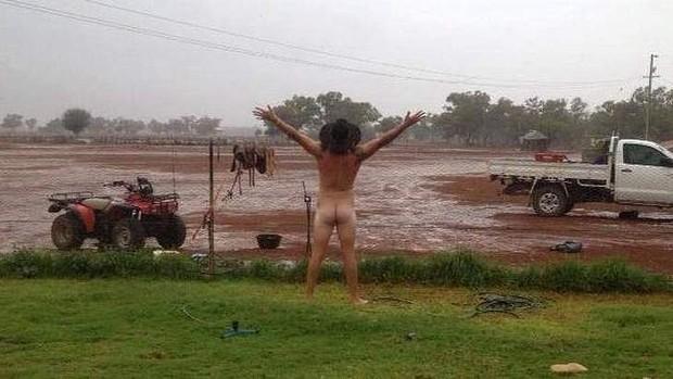 Cobar farmer James Rogers celebrating the arrival of rain. Photo: Jody Fraser