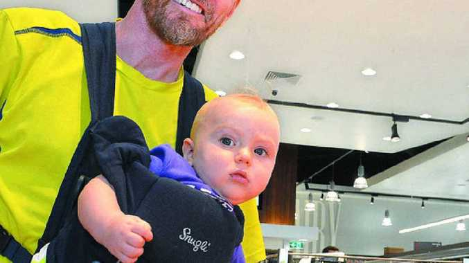 APPLE OF HIS EYE: Theodore Gordon, 8 months, and his dad Ross from Buderim check out the fruit in the new IGA Marketplace.