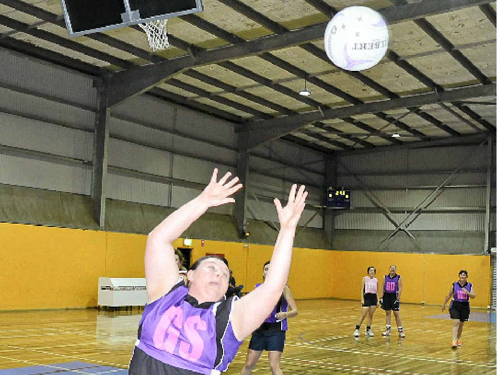 Amelia Sutton stretches in Warwick netball.