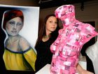 Artist Ewalina Powell with pieces from her exhibition at Gatakers art Space. Photo: Robyne Cuerel / Fraser Coast Chronicle