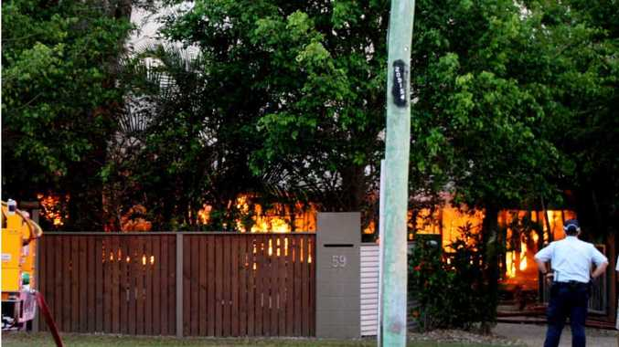 DESTROYED: Flames leap from the front of the house in Annie Dr, Peregian Beach.