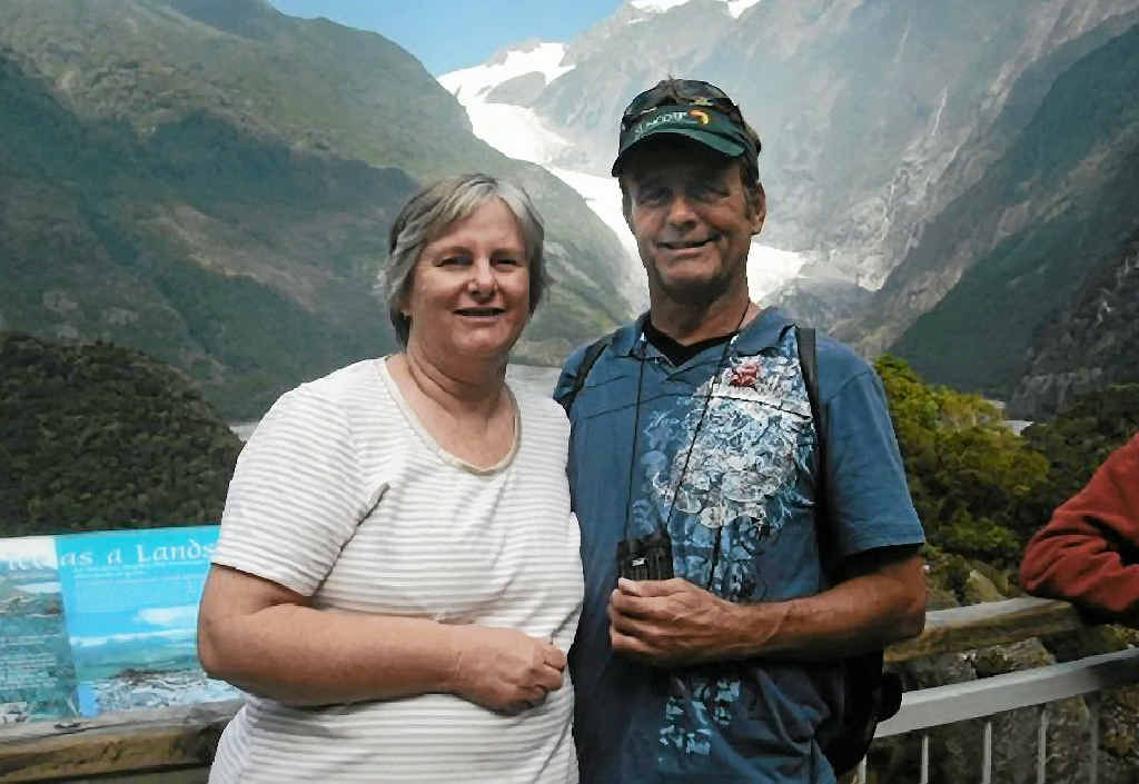 ABOVE: Catherine and Robert Lawton, of Springfield Lakes, were on board Malaysia Airlines flight MH370 that went missing on it's journey from Kuala Lumpur to Beijing.