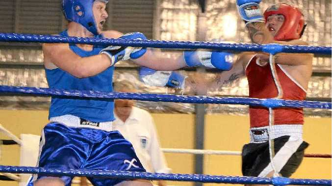 NEVER SAY DIE: A file picture of Tyler White (in blue). He lost a points decision to Owen Simpson.