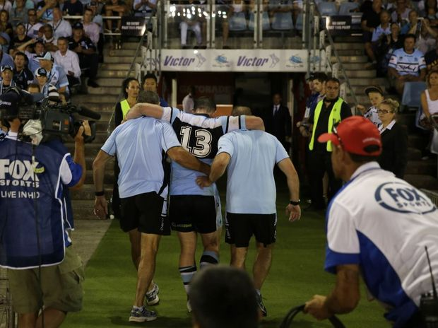 Paul Gallen carried off the field injured during the NRL round one match between the Cronulla Sharks and the Gold Coast Titans at Remondis Stadium, Sydney, Monday, March 10, 2014.