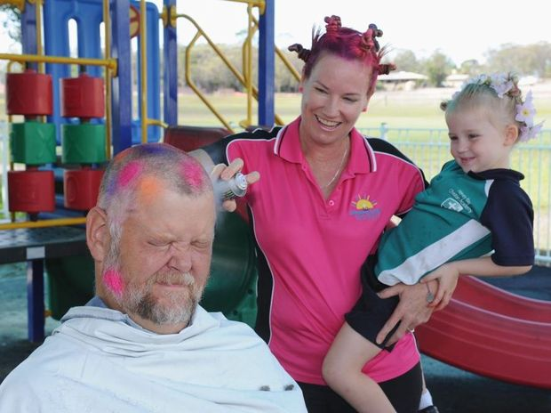 Hervey Bay Christian Academy - crazy hair day fundraiser. Principal Steve Sauvageot has his hair shaved and coloured by deputy Jane Boss-Walker to raise funds for leukaemia. Pictured with Olivia Heckels. Photo: Alistair Brightman / Fraser Coast Chronicle