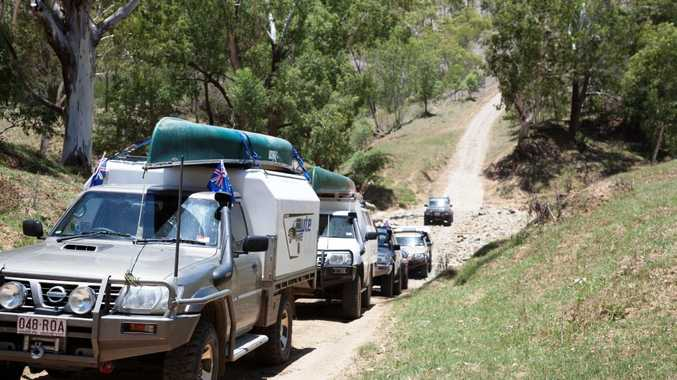 A convoy from the Mackay Landrover Club makes a crossing during an expedition in the hinterland. Photo Contributed