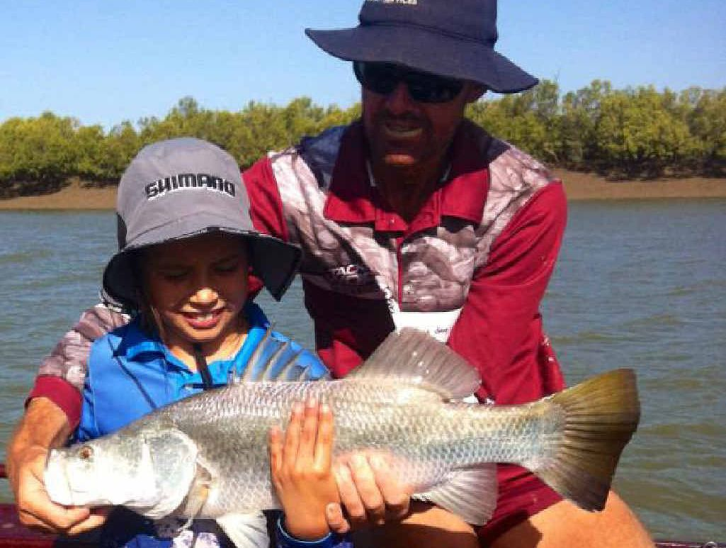 """Annika Popp with her first barramundi as she teams up with """"Team Floppy Hat"""" and Sir Johnny Mitchell."""