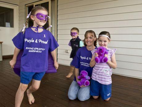 Cristal Crabtree, Matt Crabtree, Debby Cain and Tasha Crabtree go purple to raise Epilespy awareness.
