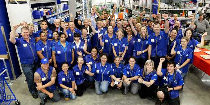 YAY TEAM: Staff and management at the new Bundamba Masters store celebrate with Ian Berry, Victor Attwood and Bruce Casos.