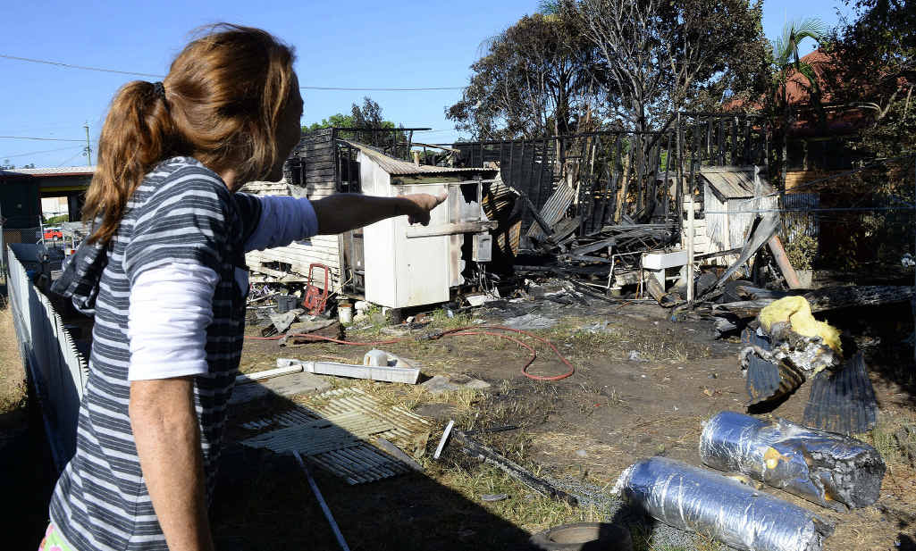 NOTHING LEFT: A neighbour checks out the aftermath the house fire. The house is disintegrated and there's basically nothing left a neighbour told the Queensland Times. The fire is being investigated.