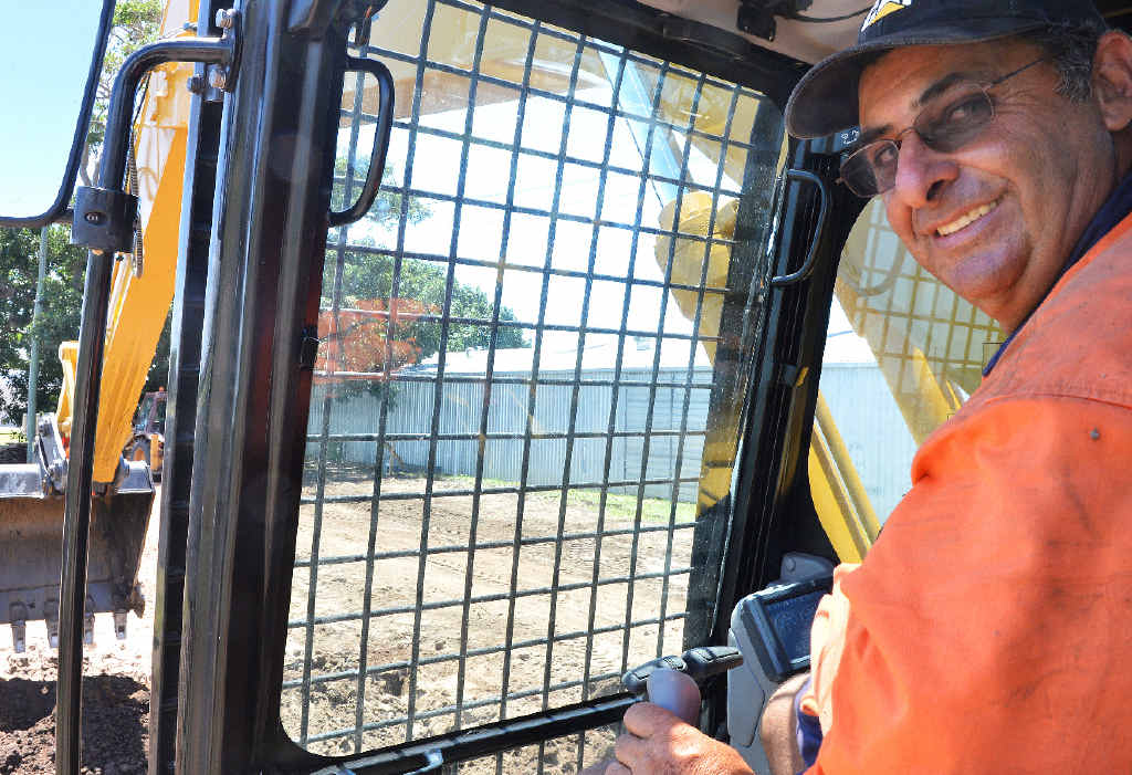 Mackay showgrounds maintenance manager Vince Muscat had a crack at using the excavator when it stopped in Mackay this week.