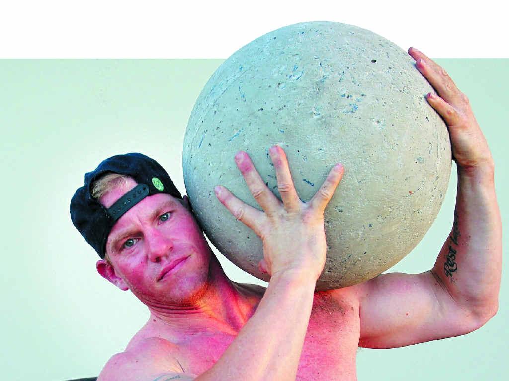 ATLAS: Caloundra's Kurt Southam hoists a concrete ball as he prepares for the Fit Bloke Challenge in Sydney in April.
