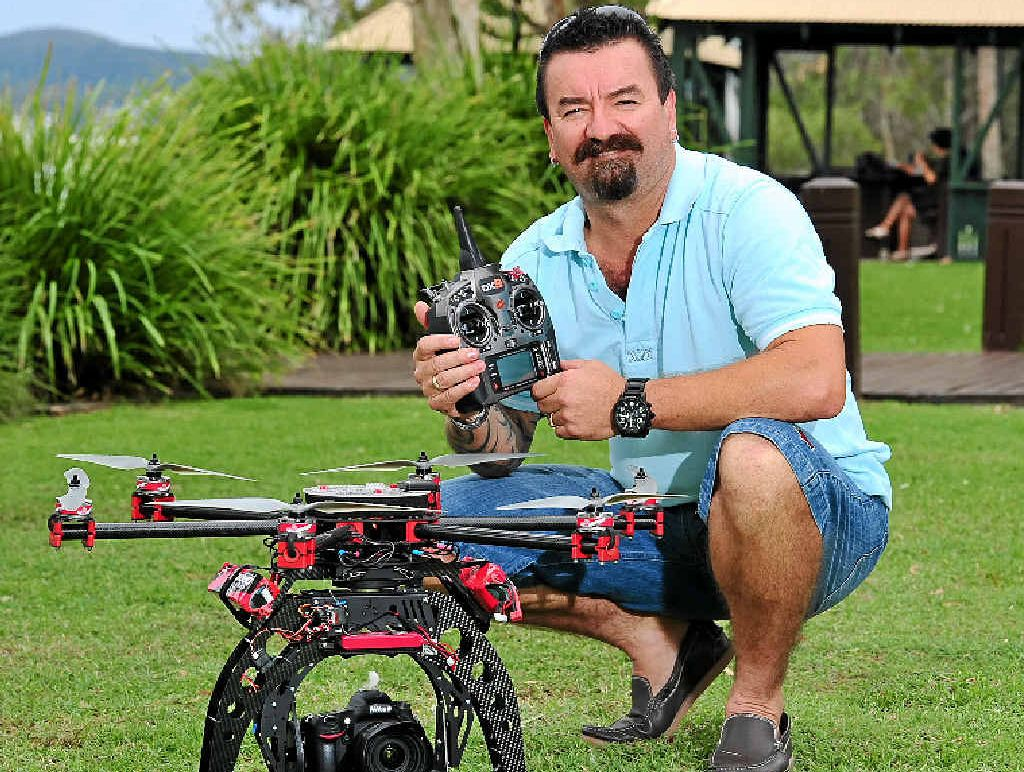 SKY'S THE LIMIT: Noosaville photographer Michael Garnham with his drone he will use for aerial work.