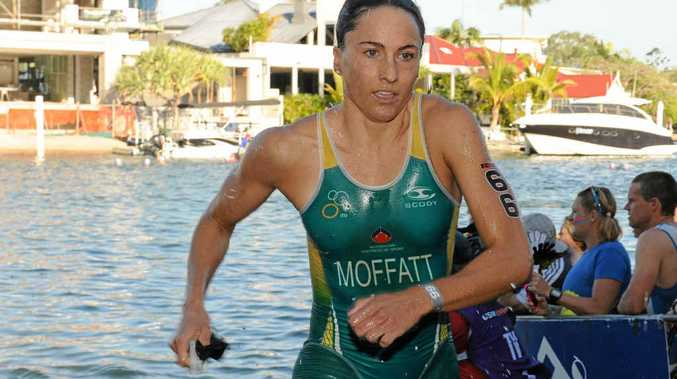ON HER WAY TO VICTORY: Emma Moffatt heads for the transition after completing the swim leg at last year's Noosa Triathlon.