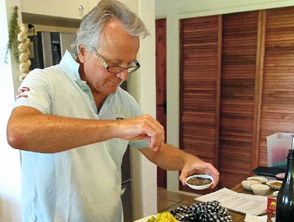 "KITCHEN WHIZ: Scott Mathias adds pepper to his ""cous cous""."