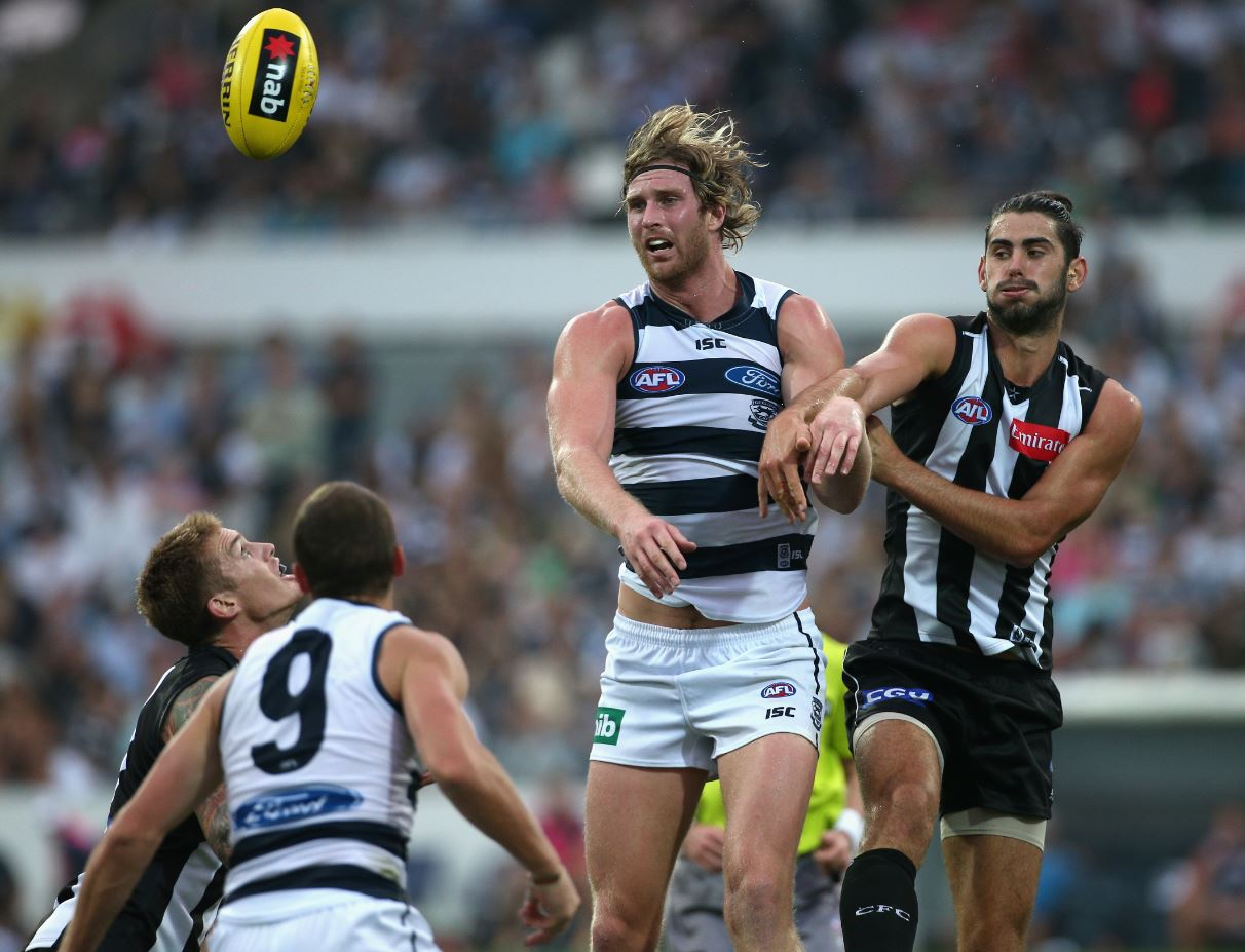 Dawson Simpson of the Cats competes with Brodie Grundy of the Magpies during the NAB challenge match between the Geelong Cats and the Collingwood Magpies.