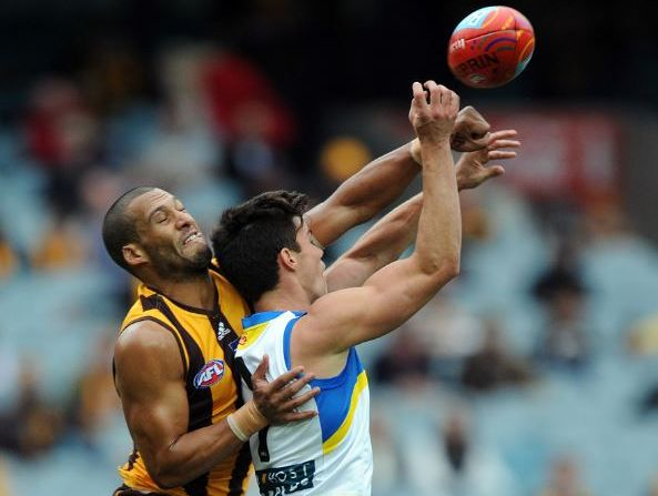Jaeger O'Meara of the Gold Coast Suns has his mark smothered by Josh Gibson of Hawthorn, during the round 9 AFL match between Hawthorn and the Gold Coast Suns in Melbourne, Sunday, May 26, 2013.