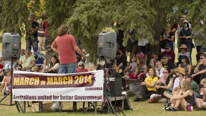 Protesters rally in Queens Park to register their vote of no confidence in the Abbott Government.