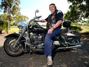 Mick gets back on bike to raise cash after near death crash
