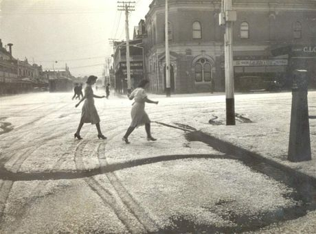 Joan Turkington opened The Way We Were and recognised herself in this iconic Toowoomba photograph of a hailstorm in Margaret St Photo Contributed