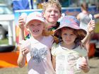 Bridie Tyson, 5, Matilda Tate, 5, and Blake Tyson, 7, cool down with a snow cone at the Jock Butterfield Rugby League Carnival at Torbanlea.