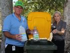Community health, education and training portfolio councillor Robert Garland and waste education officer Carol McKeough check the contents of a kerbside recycling bin.