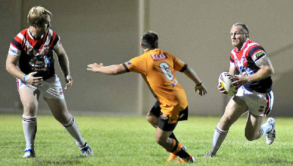 Luke Dyer looks for a hole in the Wallabys defence.