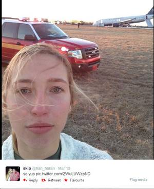 Hannah Udren takes a selfie in front of the crashed plane