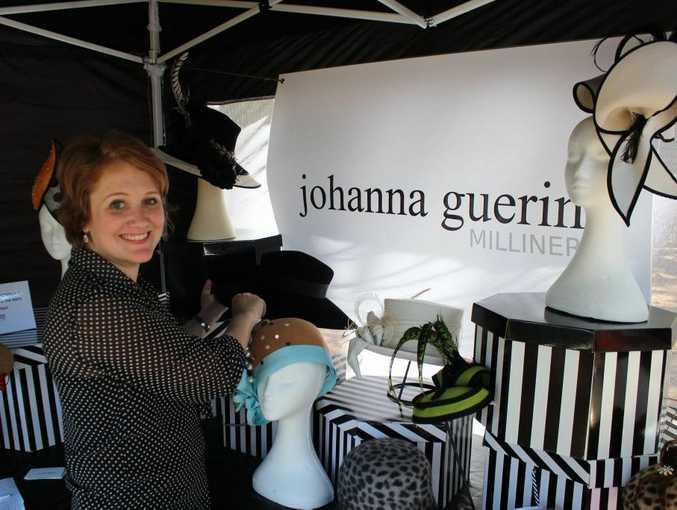 Milliner Johanna Guerin adjusts her display at the Queens Park Markets.