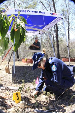 Police officers excavate a Gin Gin property for the remains of a number of babies believed to have been concealed on the land more than a decade ago. Photo Contributed