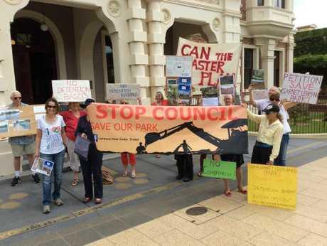 Protestors against detention basins in Garnet Lehmann Park rally outside City Hall.