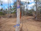 SEARCH CONTINUES: Police tape blocks the entrance to a property near Gin Gin where police are searching for the remains of a number of babies believed to have been concealed on the property over a decade ago. Photo: Max Fleet / NewsMail