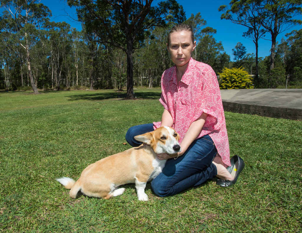 WILD DOG WARNING: Heritage Park resident Sherrie Maher, pictured with her corgi Wellington, grieves the loss of her dachshund that was mauled by wild dogs. INSET: One of the wild dogs pictured at Heritage Park. TREVOR VEALE