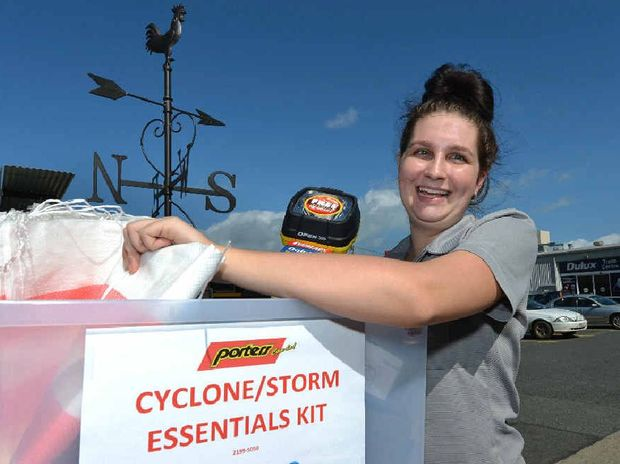BE PREPARED: Porters Mackay sales assistant Darcie Stack with the cyclone emergency kit the store has put together. With more wet weather forecast for Mackay, Porters will host a timely storm safe demonstration on Saturday.